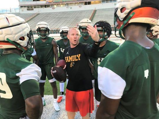 FAMU outside linebackers/nickelbacks coach Dan Lemke goes over coverage schemes with players.