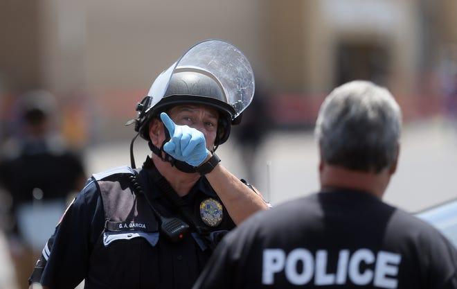 El Paso Police look for a gunman at Walmart near Cielo Vista Mall in El Paso on Saturday, Aug. 3, 2019.