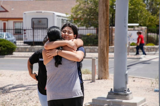 Tabitha Estrada, 19, hugs her mother Rebeca Rivas, 40, an hour after being trapped in a Walmart in El Paso as an active shooter entered the business.