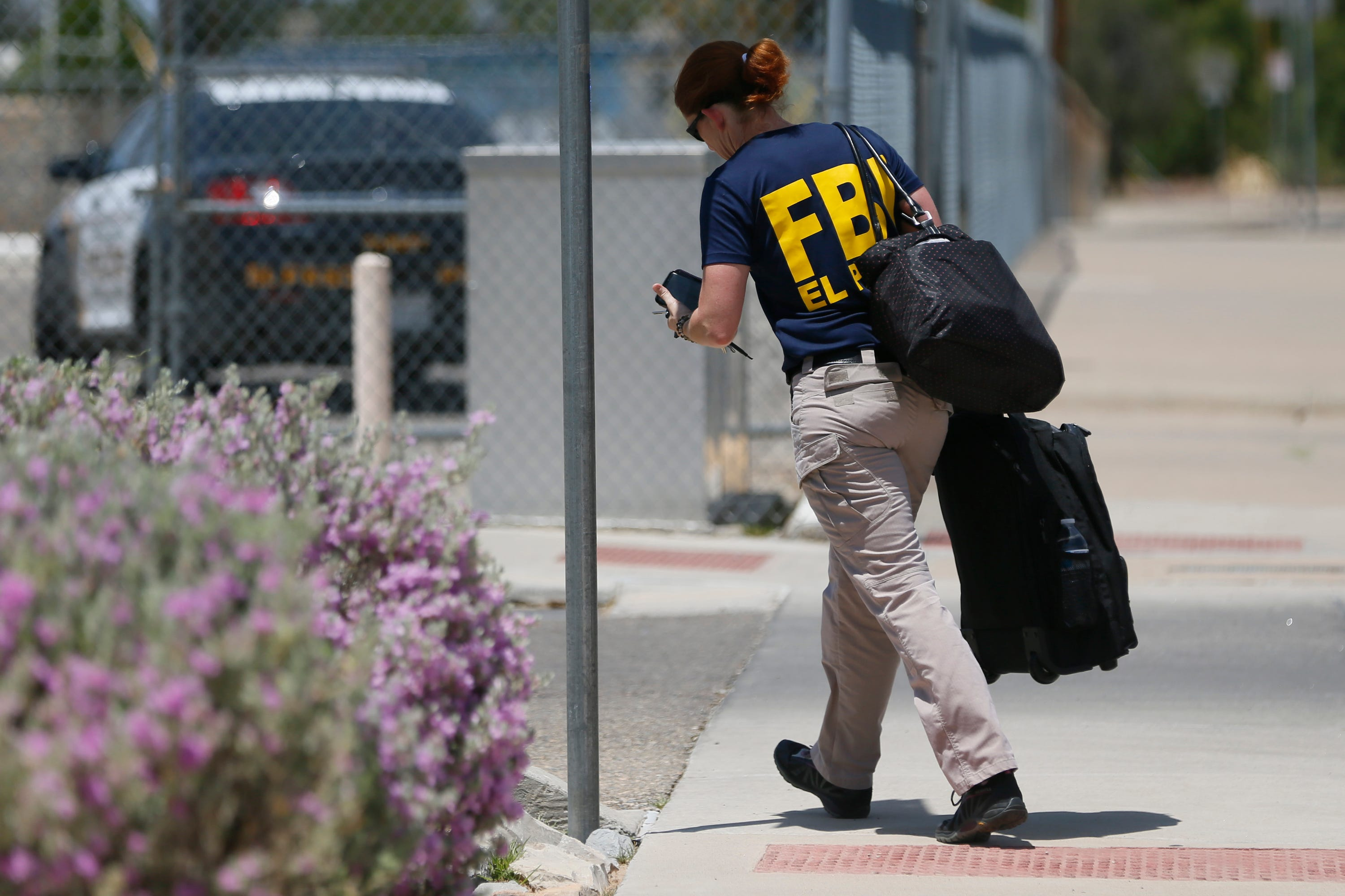 Federal Bureau of Investigation arrives at MacArthur Elementary while the school is being used a re-unification center during the aftermath of a shooting at the Walmart in the Cielo Vista Mall area Saturday, Aug. 3, in El Paso.