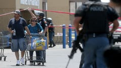 Walmart customers are escorted from the store after a shooter opened fire on shoppers at the Cielo Vista Mall location in El Paso on Saturday, Aug. 3, 2019.