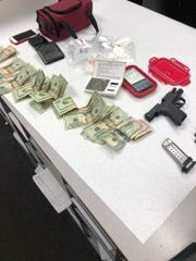 Cash, gun and narcotics seized by Oxnard police.