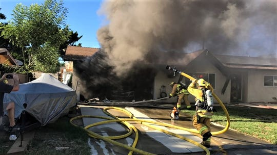 Ventura County Fire Department crews work Friday to knock down a blaze at a house in the 3500 block of Royal Avenue in Simi Valley.