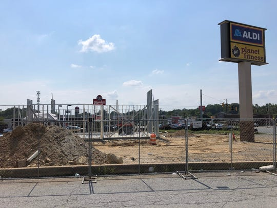 A Starbucks with a drive-thru is under construction in the parking lot of the Aldi and Planet Fitness on Kirkwood Highway.