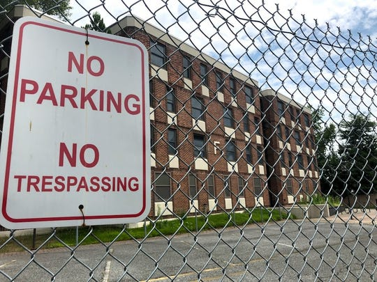 The UD Dickinson dormitories, located on Hillside Road in Newark, are currently fenced off. A plan to build apartments and townhomes in their place went before the city planning commission Tuesday night.