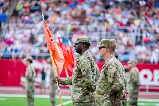 Delaware National Guardsmen from the 198th Expeditionary Battalion are honored before deployment on Saturday, Aug. 3, at Delaware State University. The soldiers are trained to provide battlefield support while deployed.