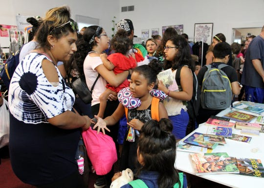 St Matthew prepared 200 backpacks filled with school supplies to give to kids Saturday, Aug. 3, 2019, returning to school. Clothes and shoes were also available for children and their parents. Anything left after the event was donated to Faith Mission.