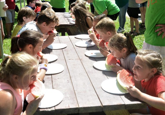 Kids get ready to compete in the melon eating contest during Saturday's Dresden Melon Festival.