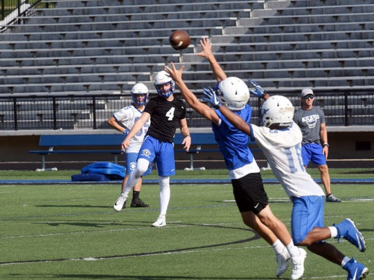 Zanesville senior quarterback Ben Everson fires a pass during a 7-on-7 drill during practice. Everson will lead a Blue Devils offense with plenty of potential and talent.