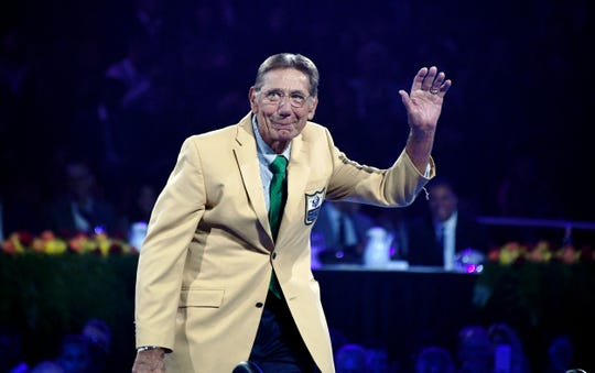 Joe Namath acknowledges the crowd during the Enshrinees Gold Jacket Dinner at Memorial Civic Center and Cultural Center.