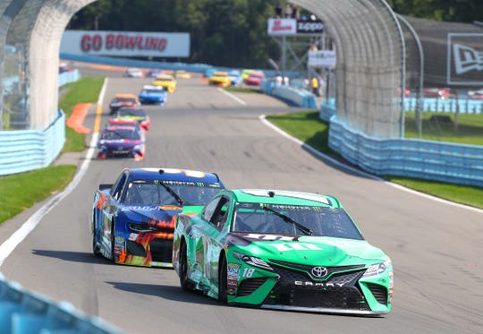 Kyle Busch (18) leads Chase Elliott (9) during the early stages of the 2018 Go Bowling at The Glen.