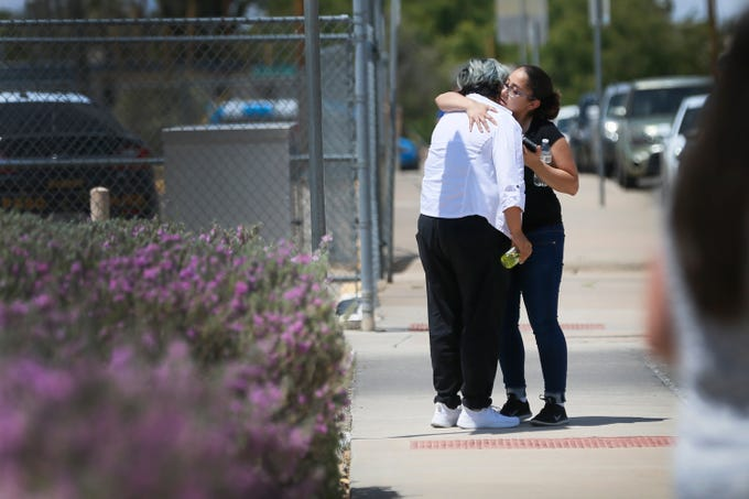 People arrive at MacArthur Elementary looking for family and friends as the school is being used a re-unification center during the aftermath of a shooting at the Walmart in the Cielo Vista Mall area Saturday, Aug. 3, 2019 in El Paso, Texas.