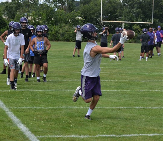 A Lakeview receiver makes a one-handed catch during a drill at team camp for the Spartans earlier this summer.