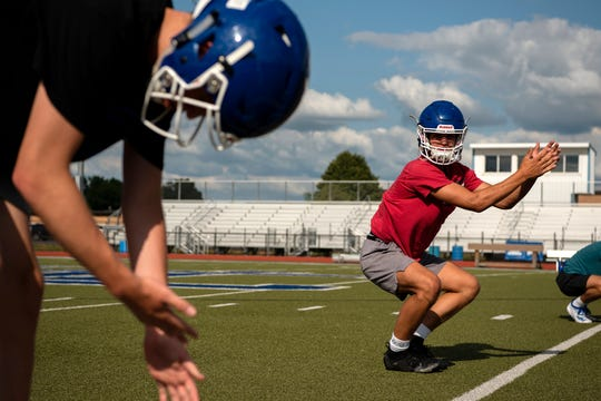 Harper Creek football players begin practice on Wednesday, July 31, 2019 at Harper Creek High School in Battle Creek, Mich.