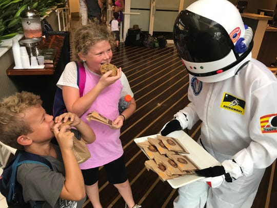 Addison, 9, and Lucas Philosophos, 6, St. Augustine, sample cookies as part of the National Chocolate Chip Cookie celebration at DoubleTree Suites Hilton Hotel Melbourne Beach Oceanfront.