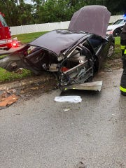 Two people survived after the car they were split in half after striking an oak tree in Palm Bay
