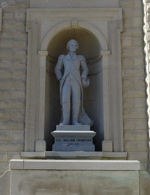 A statue of Col. William Crawford stands in its niche in front of the Crawford County Courthouse. The county named in the colonel's honor marks its bicentennial in 2020.