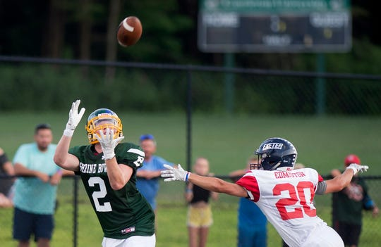 Burr and Burton's Jake Baker, left, hauls in a 40-yard touchdown catch during the 2019 Shrine Maple Sugar Bowl at Castleton University on Saturday, Aug. 3.