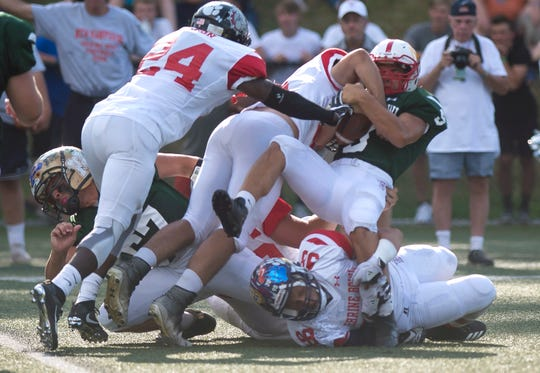 Rutland's Dakota Peters, right, is turned back by a trio of New Hampshire players during the 2019 Shrine Maple Sugar Bowl at Castleton University on Saturday, Aug. 3.