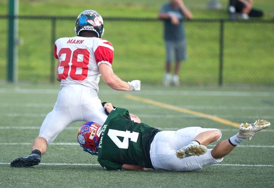 Hartford's Nick Porter brings down New Hampshire's Cameron Mann during the 2019 Shrine Maple Sugar Bowl at Castleton University on Saturday, Aug. 3.