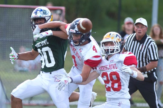 Two New Hampshire players draw a pass interference call guarding Fair Haven's Jesse Tucker (80) during the 2019 Shrine Maple Sugar Bowl at Castleton University on Saturday, Aug. 3.