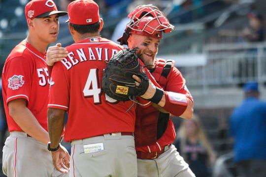 Aug 4, 2019; Atlanta, GA, USA; Cincinnati Reds catcher Tucker Barnhart (right) reacts with teammates after defeating the Atlanta Braves at SunTrust Park. Mandatory Credit: Dale Zanine-USA TODAY Sports