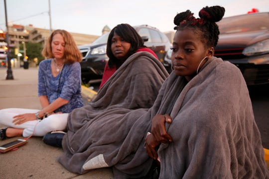 (right to left) Witnesses Nikita Papillion, 23, of Five Oaks, Tanycia Leonard, 28, of Kettering, and Tiffany McConnell, 43, of Vandalia, recall their night out in the Oregon District before gunfire broke out in Dayton, Ohio, on Sunday, Aug. 4, 2019. Ten people are dead, including the suspected shooter, and 26 are injured after shooting broke out in Dayton's Oregon District. The suspected used a .223 caliber rifle and was found wearing body armor and multiple spare magazines, according the the city's mayor Nan Whaley. Dayton Police on patrol in the entertainment district responded and neutralized the shooter in less than one minute, the mayor said.