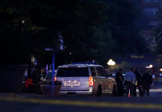 Investigators from the Dayton Police, Ohio State Highway Patrol, ATF and FBI work the scene of a deadly mass shooting in the Oregon District area of Dayton, Ohio, on Sunday, Aug. 4, 2019.