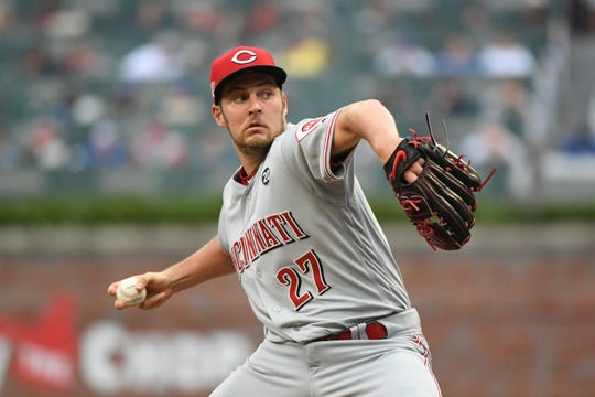 Aug 3, 2019; Cumberland, GA, USA; Cincinnati Reds starting pitcher Trevor Bauer (27) pitches against the Atlanta Braves during the first inning at SunTrust Park. Mandatory Credit: Adam Hagy-USA TODAY Sports