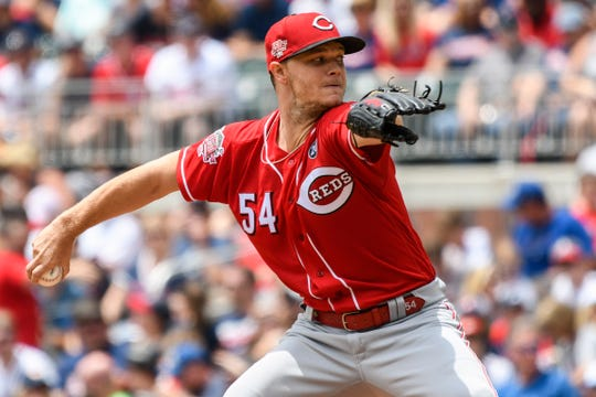 Aug 4, 2019; Atlanta, GA, USA; Cincinnati Reds starting pitcher Sonny Gray (54) pitches against the Atlanta Braves during the first inning at SunTrust Park. Mandatory Credit: Dale Zanine-USA TODAY Sports