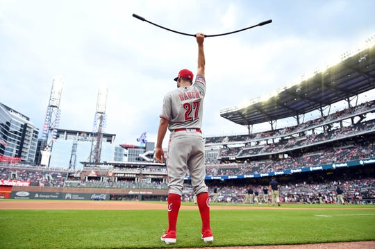Aug 3, 2019; Cumberland, GA, USA; Cincinnati Reds starting pitcher Trevor Bauer (27) warms up prior to the game against the Atlanta Braves at SunTrust Park.
