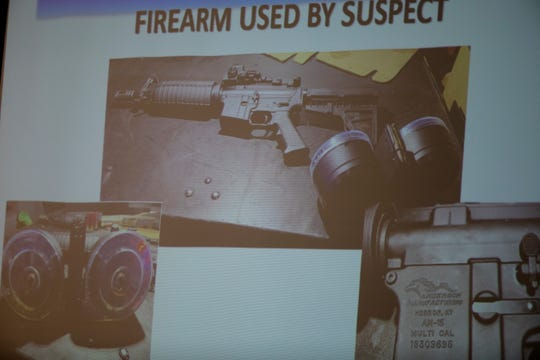 The rifle used by Connor Betts is projected on a screen during a news conference about the Aug. 4, 2019 mass shooting in Dayton's Oregon District that left 10 dead, including Betts.