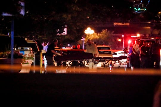 Bodies are removed from at the scene of a mass shooting, Sunday, Aug. 4, 2019, in Dayton, Ohio. Several people in Ohio have been killed in the second mass shooting in the U.S. in less than 24 hours, and the suspected shooter is also deceased, police said.