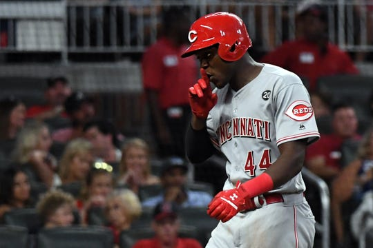 Aug 3, 2019; Cumberland, GA, USA; Cincinnati Reds right fielder Aristides Aquino (44) celebrates his first career home run against the Atlanta Braves during the seventh inning at SunTrust Park.
