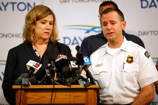 Dayton mayor Nan Whaley and police Lt. Col. Matt Carper give the latest update on the overnight mass shooting during a press conference at the Dayton Convention Center in downtown Dayton, Ohio, on Sunday, Aug. 4, 2019. Ten people are dead, including the suspected shooter, and 26 are injured after shooting broke out in Dayton's Oregon District. The suspected used a .223 caliber rifle and was found wearing body armor and multiple spare magazines, according the the city's mayor Nan Whaley. Dayton Police on patrol in the entertainment district responded and neutralized the shooter in less than one minute, the mayor said.