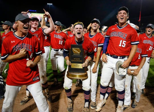 Members of the Urbandale baseball team celebrate a 8-2 win over Johnston in the Iowa Class 4A state baseball championship game on Saturday, Aug. 3, 2019, at Principal Park in Des Moines.