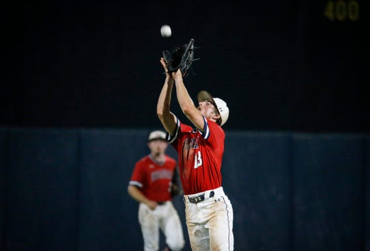 Urbandale senior right fielder Brook Heinen catches a fly ball in the seventh inning against Johnston in the Iowa Class 4A state baseball championship game on Saturday, Aug. 3, 2019, at Principal Park in Des Moines.