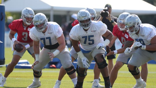 Detroit Lions offensive lineman Frank Ragnow (77) and Leo Koloamatangi (75) go through drills during training camp Sunday, August 4, 2019 in Allen Park.