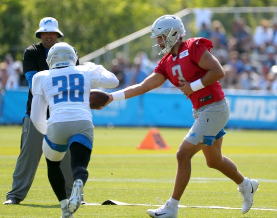 Detroit Lions quarterback Tom Savage hands off to Ty Johnson during training camp Sunday, August 4, 2019 in Allen Park.