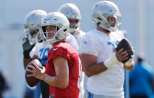 Detroit Lions quarterback Matthew Stafford looks downfield during drills at training camp Sunday, Aug. 4, 2019, in Allen Park.