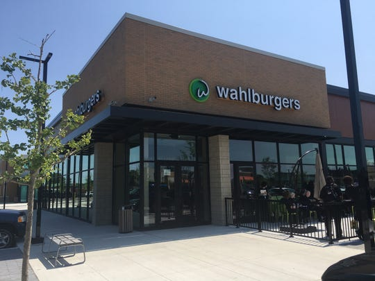 Three sides of Wahlburgers in Royal is all windows with views of Woodward Avenue.