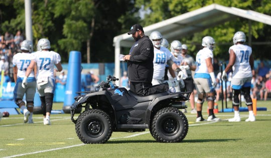 Detroit Lions head coach Matt Patricia watches practice from his ATV during training camp Sunday, August 4, 2019 in Allen Park.