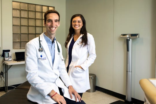 Dr. Paul Thomas and Dr. Raquel Orlich of Plum Health are photographed in their office in Detroit. Their direct primary care clinic doesn't take insurance.