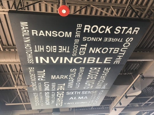 The names of movies Mark Wahlberg appeared in hangs from the ceiling.