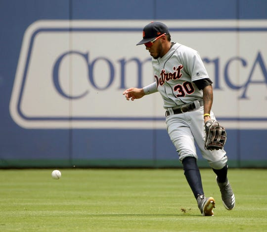 Detroit Tigers center fielder Harold Castro drops the ball after making an out during the first inning against the Texas Rangers, Sunday, August 4, 2019, in Arlington, Texas.