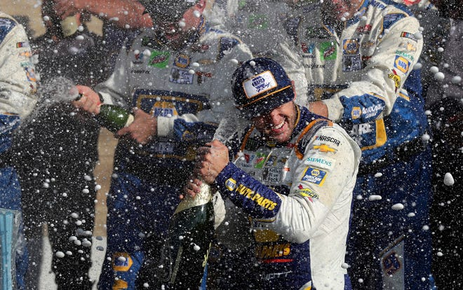 Chase Elliott celebrates his victory with his pit crew after winning Sunday's NASCAR Cup Series race at Watkins Glen International.