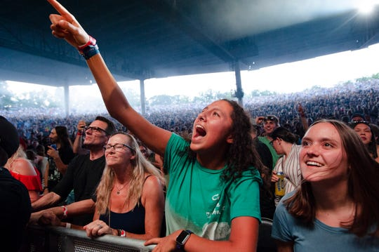 Fans enjoy the performance of Cage the Elephant at DTE Energy Music Theatre in Clarkston, Mich.