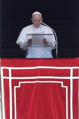 Pope Francis prays for the dead and injured of the U.S. mass shootings, during the Angelus noon prayer in St. Peter's Square at the Vatican, Sunday.