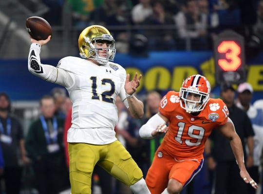 Notre Dame quarterback Ian Book (12) is back to lead the Fighting Irish's retooled offense.
