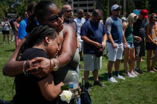 Mourners gather at a vigil following a mass shooting, Sunday in Dayton, Ohio.